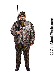 Hunter in camouflage holding a rifle with his right hand,...