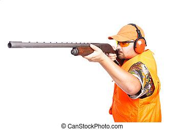 Hunter aiming pump action shotgun - Hunter aiming a pump...