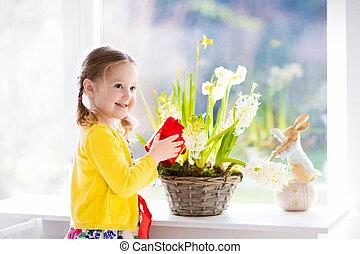 Little girl watering spring flowers - Cute girl watering...