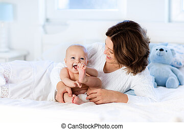 Baby and mother at home. Mom and child. - Mother and child...