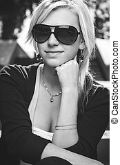 girl in sunglasses sitting on stairs - beautiful girl in...