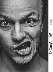 crazy man with funny facial expression - close-up of crazy...