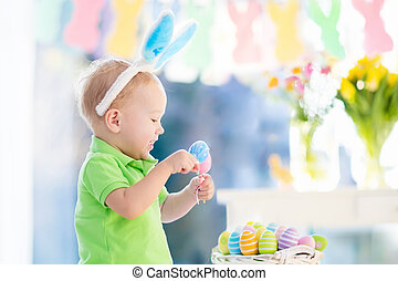 Baby with bunny ears on Easter egg hunt - Kids celebrate...