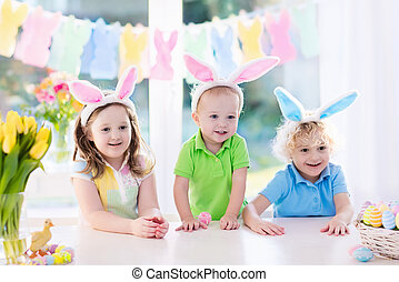 Kids with bunny ears on Easter egg hunt - Boy and girl in...