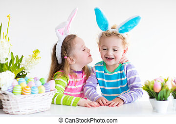 Kids with bunny ears on Easter egg hunt