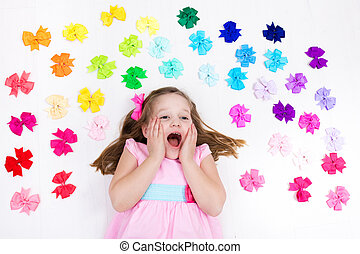 Little girl with colorful bow. Hair accessory - Little girl...