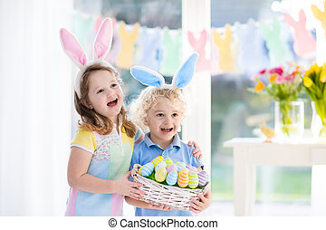 Kids with eggs basket on Easter egg hunt