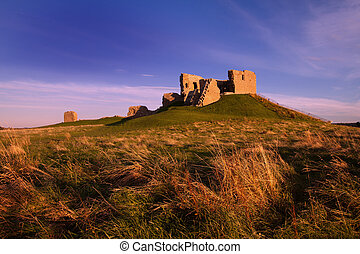 Duffus Castle, Elgin, Moray, Scotland is a ruined stone...