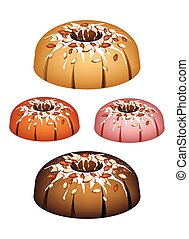 Four Bundt Cake Topped with Sugar Glaze and Almonds -...
