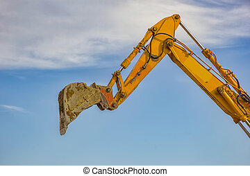 day view of single excavator boom arm with hydraulic Hoses...