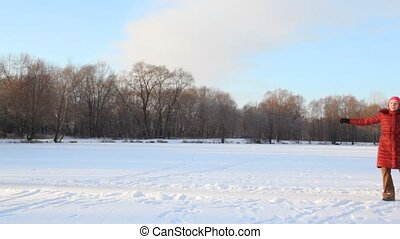 woman dancing in snowfield against forest