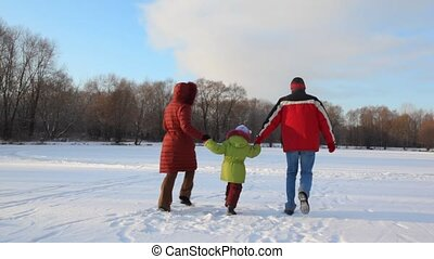 family having joined hands runs on snowfield