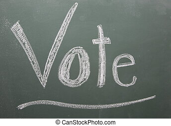 Vote Written on Blackboard - Vote written on blackboard in...