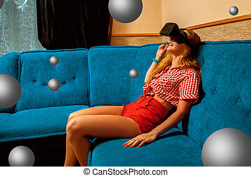 woman in virtual reality glasses - horizontal photo of happy...