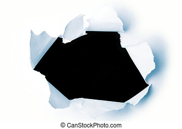Hole in paper  - Hole ripped in paper on black