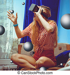 woman in VR glasses - young woman in virtual reality glasses...