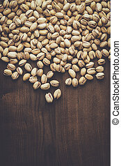 pistachios background - many roasted pistachios on the...
