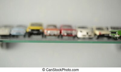 collection of toy cars on the shelf