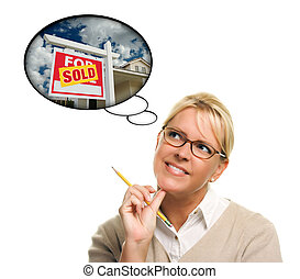 Woman with Thought Bubbles of a Sold Real Estate Sign to a...