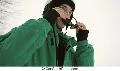 Snowboarder Wears Black Sunglasses - Young attractive...