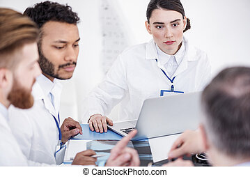 Cool doctors arguing during meeting in office