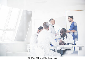 Outgoing physicians deliberating at conference - Cheerful...