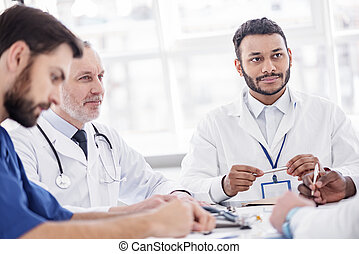 Serene doctors hearing their partner during conference -...