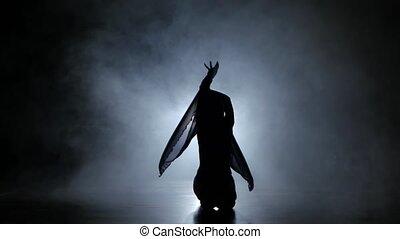 PJ girl dancer in studio with smoke against black...