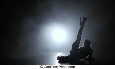 PJ woman dancer in studio with smoke on the floor, model has...