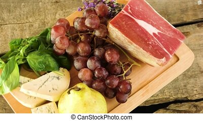 Wooden board and raw food. Frozen meat, cheese and fruits....