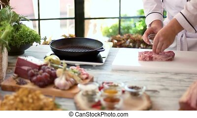Raw beef steak and spices. Male chef working. Tasty meat...
