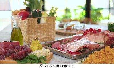 Wooden table with food. Fruits, roquefort cheese and meat....