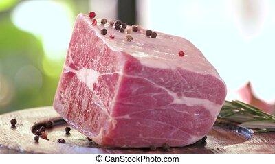 Frozen meat piece. Raw beef on wooden plate. Best rustic...
