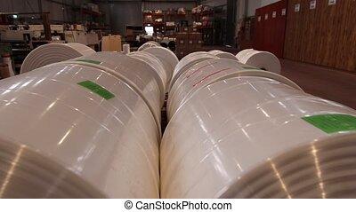 Massive rolls of plastic inside factory - Modern generic...