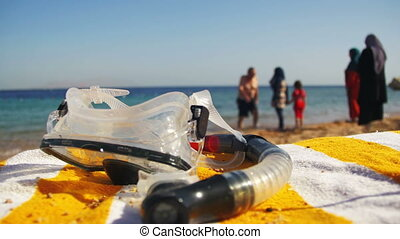 Diving Mask with a Tube for Snorkeling Lying on a Lounger on...