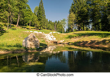 Small pond in the woods of the Alps. - Small pond in the...
