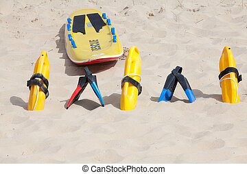 Bright yellow flotation devices and rescue equipment