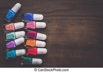 nail polish bottles on brown wooden table - nail polish...