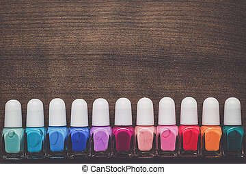 nail polish bottles on brown wooden table - nail polish...