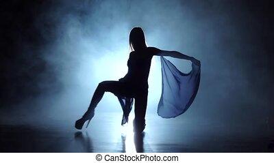Model pj girl dancer in studio with smoke. Black background...
