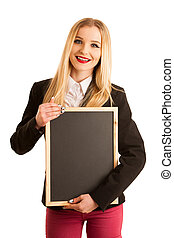 cute young business woman golds blank black board with place for advertisement or text