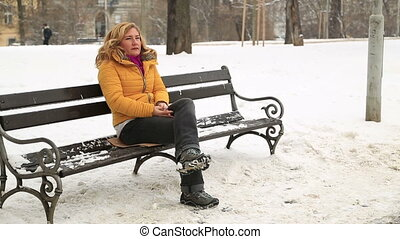 Sick woman sneezing at the outdoors - Portrait of a blond...