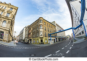 typical old buildings in Berlin Mitte with blue water...