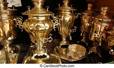 Shop with polished to golden samovars and faceted glass in metal holders