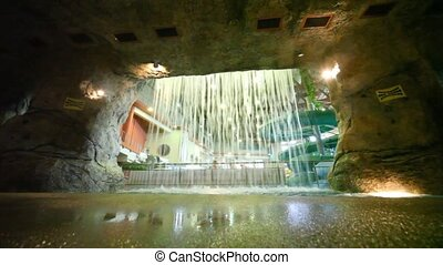stone cave with a waterfall in waterpark - Dark stone cave...