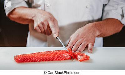 Preparing sashimi set in restaurant kitchen - Chef coock...
