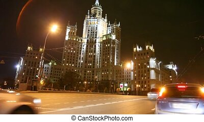 Night car driving in moscow past by building