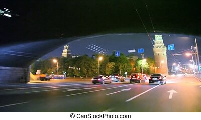 Car driving past by night Kremlin - timelapse car driving...
