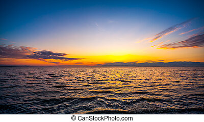 Colorful sky and water in lake Paliastomi in morning , Poti,...