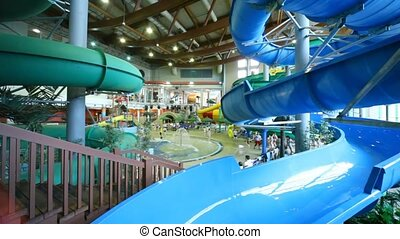 Stairs leading to water park with big pools, fountains and...